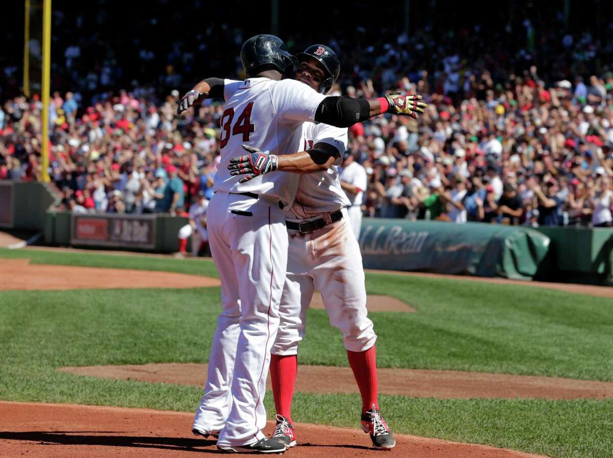 Boston Red Sox's David Ortiz, left, celebrates his home run with teammate Xander Bogaerts in the first inning of a baseball game against the Philadelphia Phillies, Sunday, Sept. 6, 2015, at Fenway Park, in Boston. (AP Photo/Steven Senne) ORG XMIT: MASR104