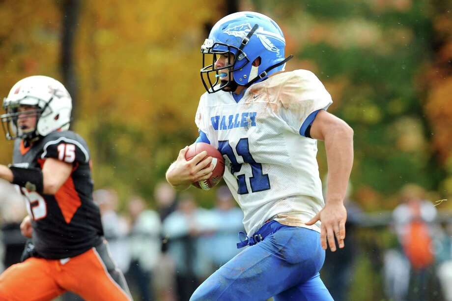Hoosic Valley's Tom Madigan, right, carries the ball as Cambridge's Ethan English moves in for a tackle during their football game on Saturday, Oct. 18, 2014, at Cambridge High in Cambridge, N.Y. (Cindy Schultz / Times Union) Photo: Cindy Schultz / 00029061A