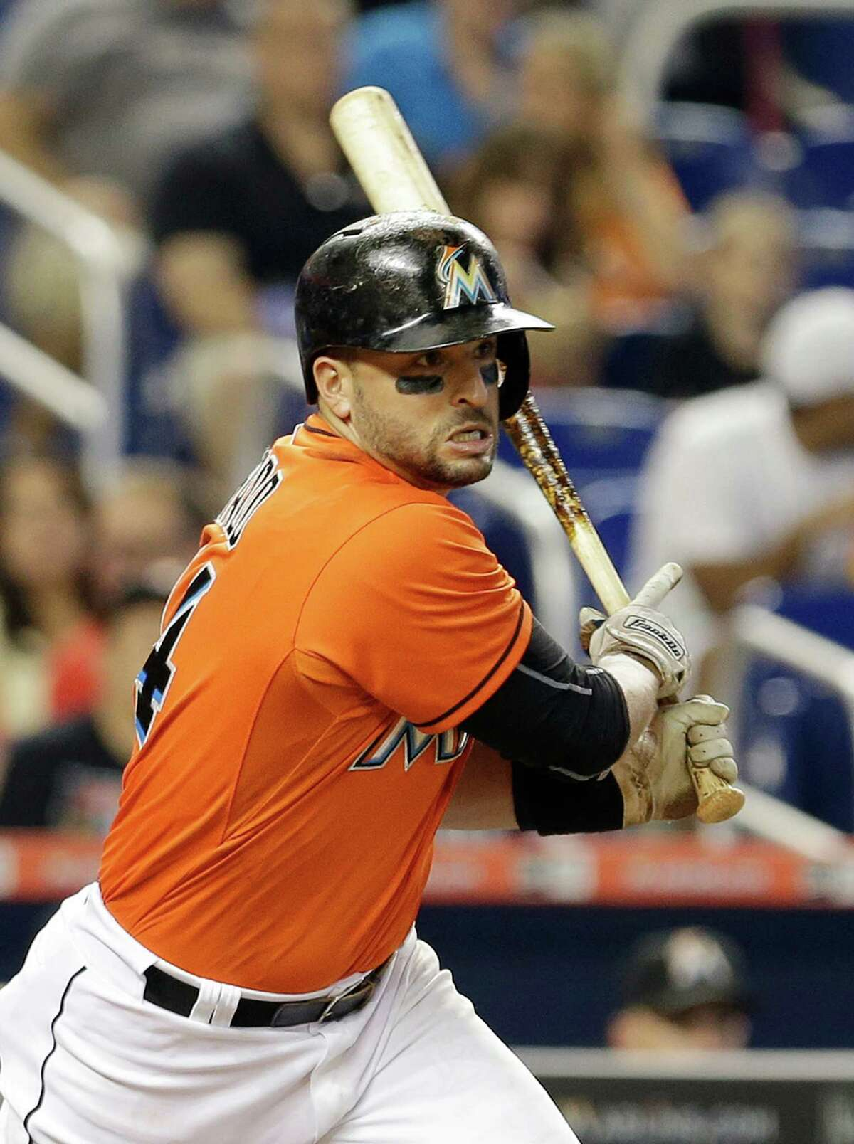 Miami Marlins' Martin Prado (14) follows through on a single against the New York Mets in the fourth inning of a baseball game, Sunday, Sept. 6, 2015, in Miami. (AP Photo/Alan Diaz) ORG XMIT: FLAD108