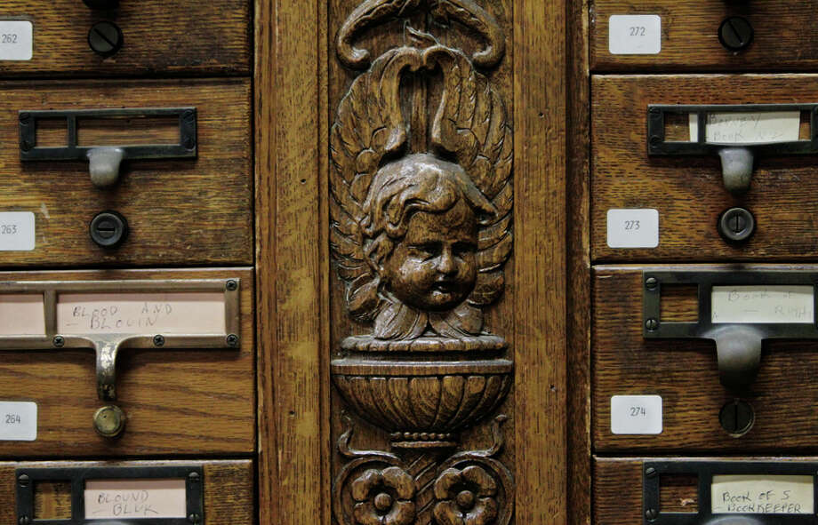 Intricate carvings mark an old wooden card catalog being stored in Brooks Hall, beneath San Francisco's Civic Center Plaza. Photo: Lea Suzuki / Lea Suzuki / The Chronicle / ONLINE_YES