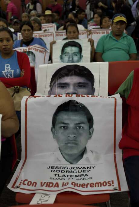 Loved ones of the 43 missing students wait Sunday in Mexico City for experts of the Inter-American Commission on Human Rights to discuss their 500-page report on the government's inquiry. Photo: OMAR TORRES, Staff / AFP