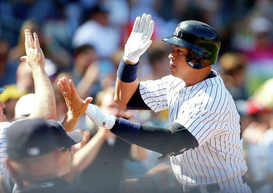 NEW YORK, NY - SEPTEMBER 06:  Alex Rodriguez #13 of the New York Yankees celebrates his sixth inning home run against the Tampa Bay Rays at Yankee Stadium on September 6, 2015 in the Bronx borough of New York City.  (Photo by Jim McIsaac/Getty Images) ORG XMIT: 538594387 Photo: Jim McIsaac / 2015 Getty Images