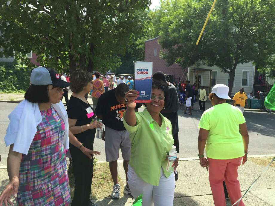 A get-out-the-vote effort was part of the backbag-giveaway/block party hosted by the Mt. Calvary Baptist Church, which is led by Pastor Charles Daniel, on Saturday Aug. 29, 2015 (Submitted photo)