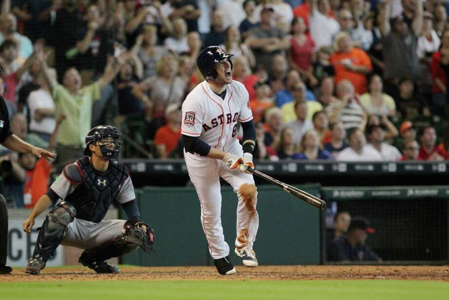 Astros third baseman Jed Lowrie let out all the frustration of a recent 0-for-28 stretch on a seventh-inning grand slam Sunday. Photo: Jon Shapley, Staff / © 2015 Houston Chronicle