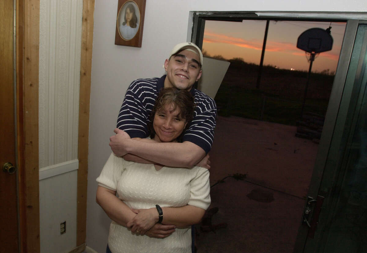 Tony Limon stands with his mother, Olivia Ramey, in their living room in 2001. Limon was sentenced to five years in prison for elbowing an opponent in a high school basketball game in 1999. Bahram Mark Sobhani/Special to the Express News