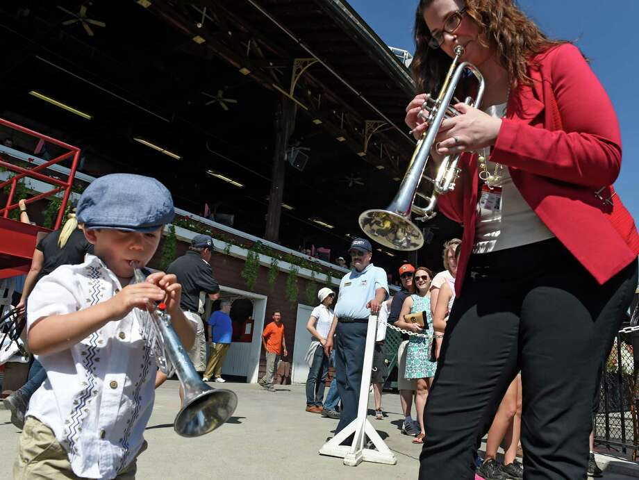 Mason Riha 2 1/2 of Scotia plays a tune with interim bugler Allyson Keyser at the Saratoga Race Course Sunday afternoon Sept. 6, 2015 in Saratoga Springs, N.Y.   (Skip Dickstein/Times Union) Photo: SKIP DICKSTEIN