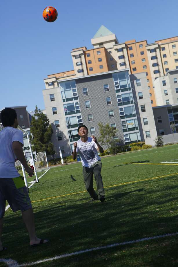 Vinh Phan, SFSU (l) and Dung Dang, City College of San Francisco (r) practicing their soccer skills on the open field at San Francisco State university September 6, 2015. Photo: Franchon Smith, The Chronicle