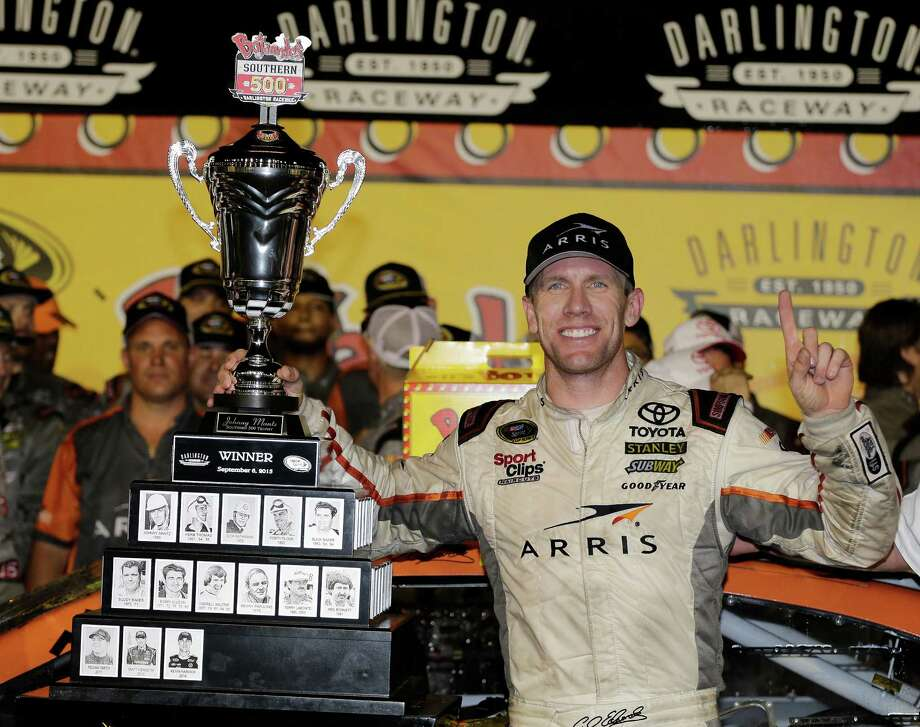 Carl Edwards celebrates in victory lane after winning a NASCAR Sprint Cup auto race at Darlington Raceway in Darlington, S.C., Monday, Sept. 7, 2015. (AP Photo/Terry Renna) Photo: Terry Renna, FRE / FR60642 AP