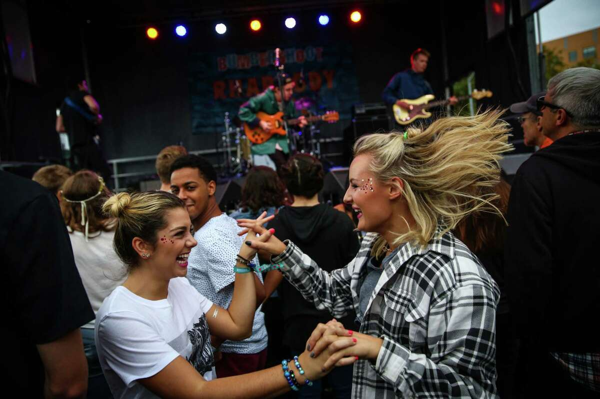 Fans dance to a performance by the band Hibou on the Rhapsody Stage during Bumbershoot at Seattle Center. Photographed on Sunday, September 6, 2015.