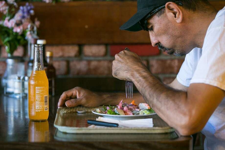 Walter Pineda eats a salad while waiting for his entree to cook at Geneva Steak House in the Outer Mission. Photo: Jen Fedrizzi, Special To The Chronicle