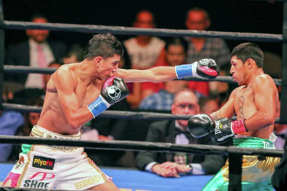 San Antonio super featherweight Mario Barrios (left) knocked out Mexico's Jose Cen Torres in the fourth round at the American Bank Center in Corpus Christi. Photo: Photos By Micah DeBenedetto /For The Express-News / ©2015 San Antonio Express-News