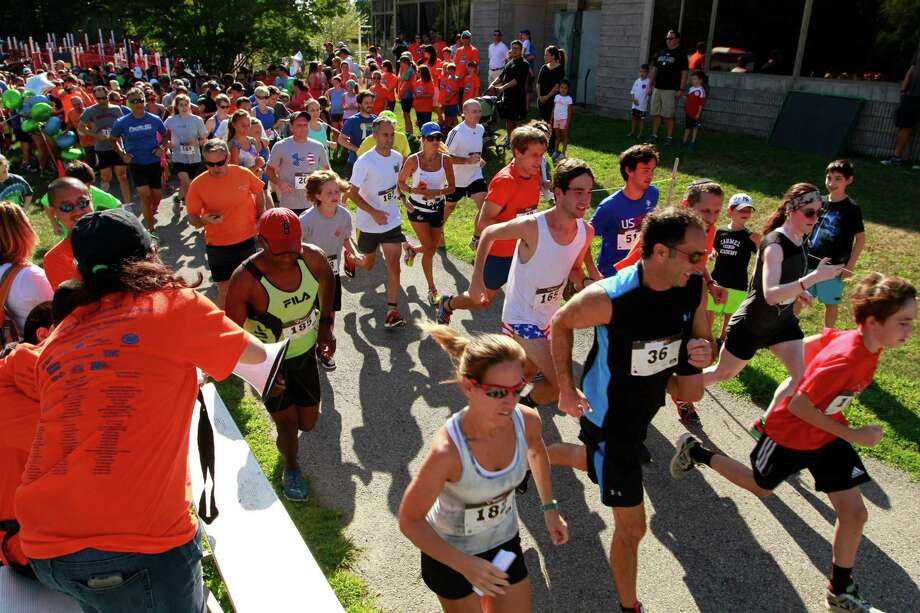 Participants take off from the start line during the annual Give a Child a Jump Start - 5k/10k Walk/Run &Family Fun Day at the JCC of Stamford on Monday Sept. 7, 2015. The event drew more than 400 participants and raise over $40,000 to help support the JCC Jump Start and Early Childhood Special Needs programs. Photo: Matthew Brown, For Hearst Connecticut Media / Connecticut Post Freelance