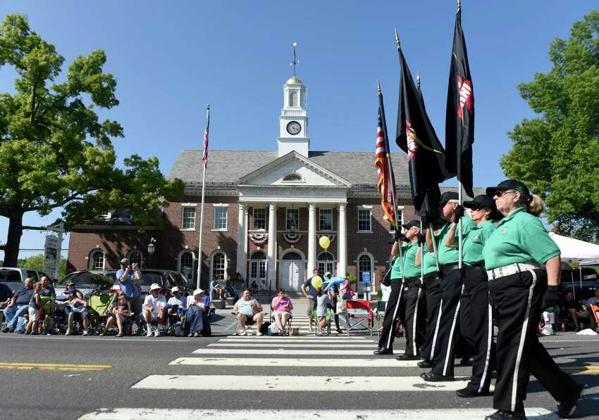 Members of the Connecticut Alumni Drum & Bugle Corps march past Edmond Town Hall during the 54th Annual Newtown Labor Day Parade in Newtown, Conn. Monday, Sept. 7, 2015. The theme for 2015 was