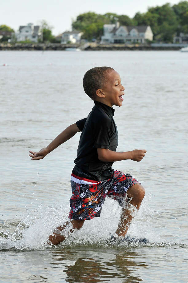 Visiting family from Philadelphia, Gavin Allen, 5, runs through the water at West Beach on Wednesday, Aug. 26. Photo: Jason Rearick / Hearst Connecticut Media / Stamford Advocate