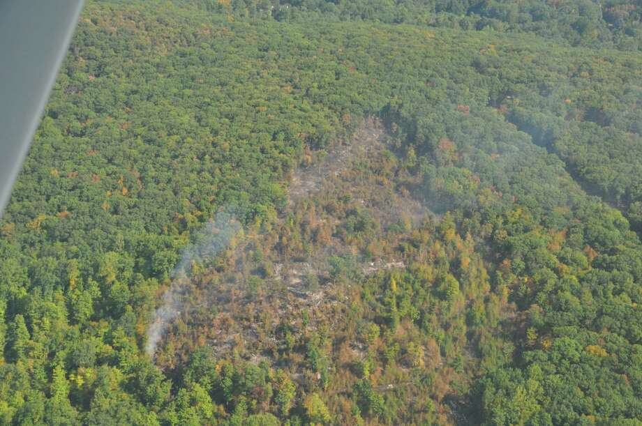 A 28 acre brush fire was brought under control Monday. The fire was first spotted by The Connecticut Civil Air Patrol on Saturday. Photo: Connecticut Civil Air Patrol