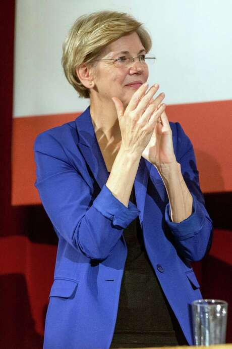 Sen. Elizabeth Warren, D-Mass., applauds as President Barack Obama speaks at the Greater Boston Labor Council Labor Day Breakfast, Monday, Sept. 7, 2015, in Boson. Obama will sign an Executive Order requiring federal contractors to offer their employees up to seven days of paid sick leave per year. (AP Photo/Andrew Harnik) Photo: Andrew Harnik, STF / AP