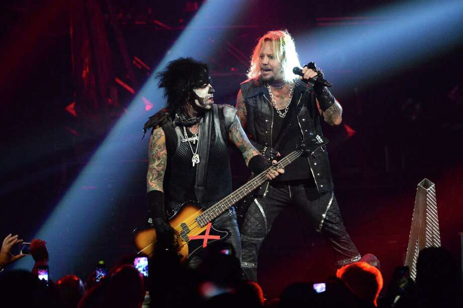 """Nikki Sixx, left, and Vince Neil perform during Mötley Crüe: The Final Tour """"All Bad Things Must Come to an End"""" tour in New York City. Photo: Kevin Mazur, Stringer / 2015 Getty Images"""