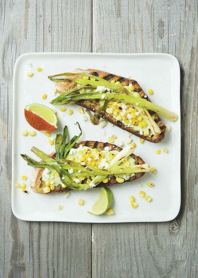 Grilled Corn and Scallion Toast with Cilantro Crema is worked with toasted country-style bread. Photo: Phaidon