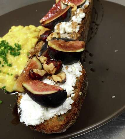 Agricole HospitalityRevival Market Where: 550 HeightsPhoto: toasted rye topped with ricotta, figs, roasted hazelnuts and syrup with a side of scrambled eggs Photo: Ryan Pera
