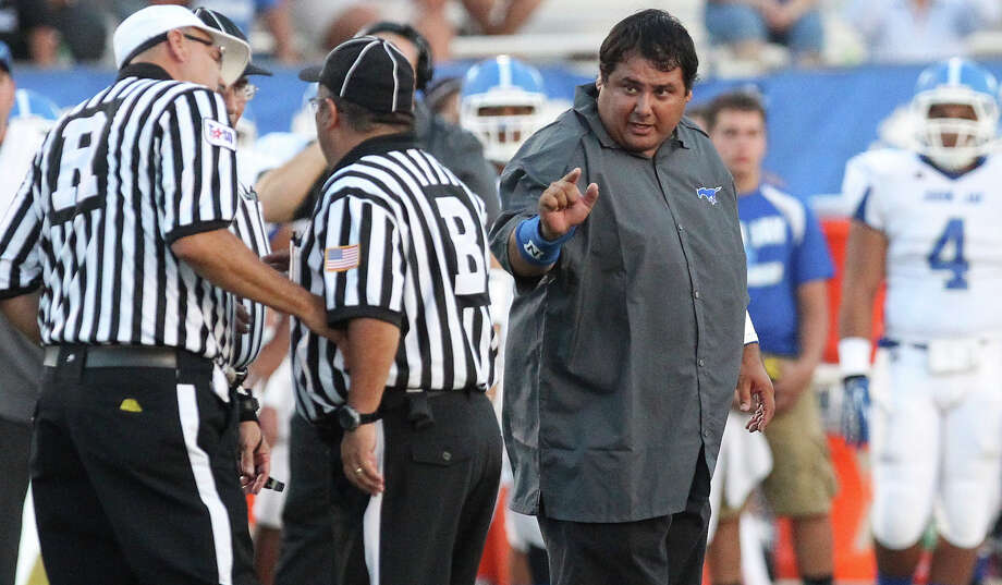 Jay head football coach Gary Gutierrez exchanges words with game officials during their game against East Central at East Central on Aug. 30, 2013. Photo: Kin Man Hui /San Antonio Express-News / ©2013 San Antonio Express-News