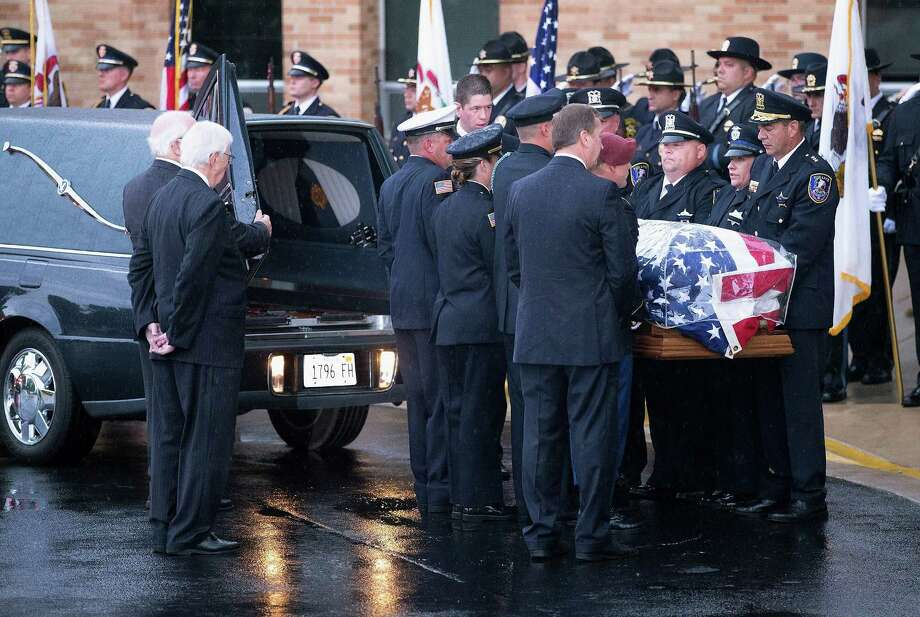 ANTIOCH, IL - SEPTEMBER 07:  The coffin of slain Fox Lake police officer Lt. Joe Gliniewicz arrives at Antioch Community High School for his visitation and funeral service on September 7, 2015 in Fox Lake, Illinois.  Gliniewicz was shot and killed on September 1, while on duty in Fox Lake. Police are searching for three suspects in connection with his death.  (Photo by Scott Olson/Getty Images) Photo: Scott Olson, Staff / Getty Images / 2015 Getty Images