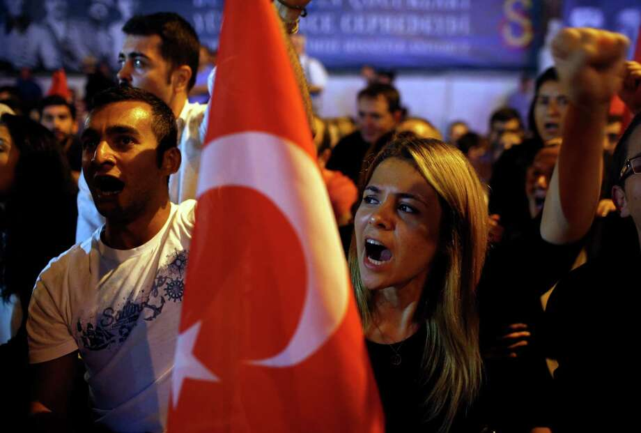 People protest to condemn terrorism Monday in Istanbul, Turkey, after the military announced that 16 soldiers were killed in a Kurdish rebel attack. Photo: Emrah Gurel, STR / AP