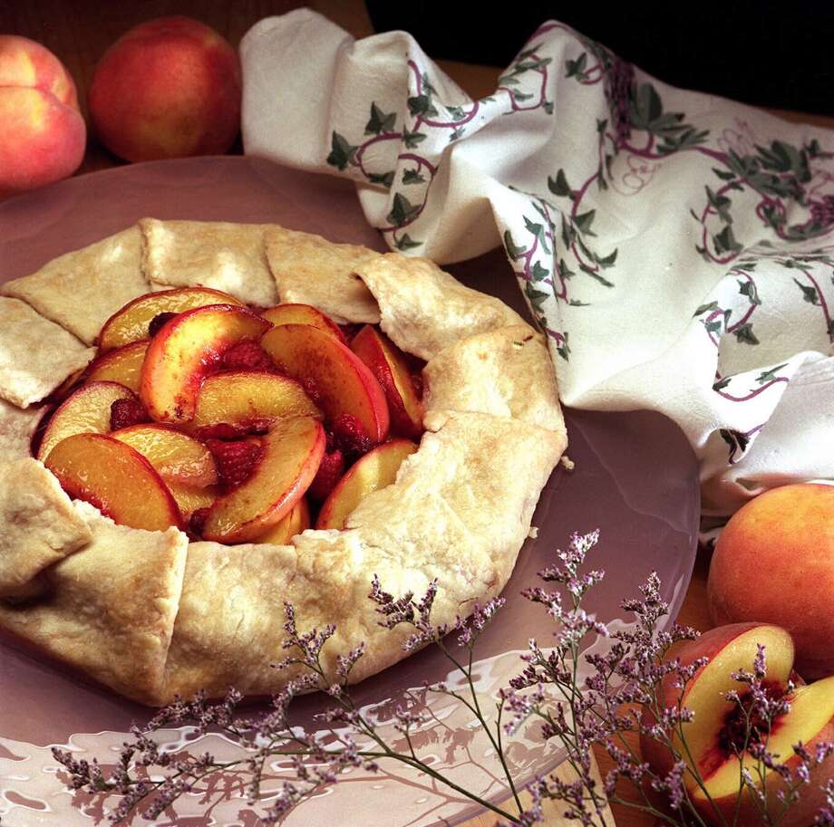 The Rustic Peach Tart is baked without a mold in a high-gluten crust. Illustrates FOOD-PIE (category d), by Russ Parsons  1997, Los Angeles Times. Moved Monday, Sept. 15, 1997. (MUST CREDIT: Los Angeles Times photo by Robert Gauthier.) Photo: ROBERT GAUTHIER / LOS ANGELES TIMES