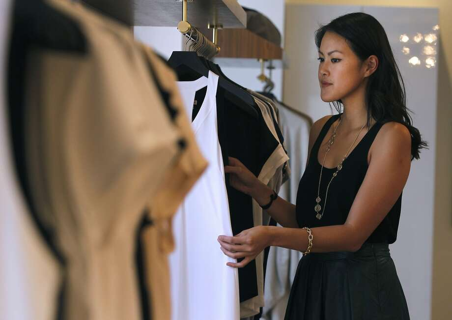 Laura Chau shops in Cuyana at Union Square in San Francisco, Calif. on Saturday, Sept. 5, 2015. It's been years since Chau has set foot in a mall and prefers to shop online and at smaller stores like Cuyana. Photo: Paul Chinn, The Chronicle