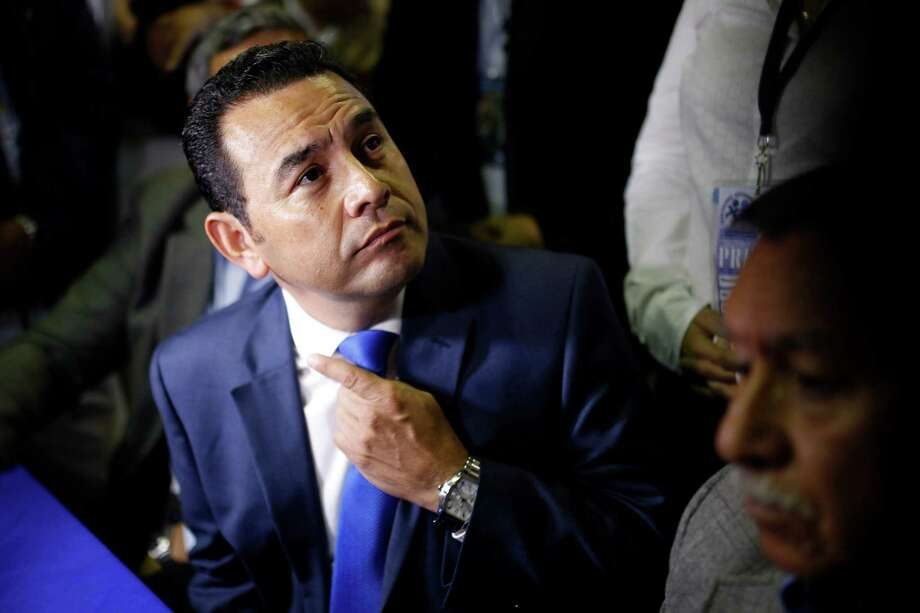 Presidential candidate Jimmy Morales of the National Front of Convergence party, listens to a question during a press conference in Guatemala City, early Monday, Sept. 7, 2015. With more than 96 percent of polling stations reporting Monday, former comedian Jimmy Morales, who has never held elective office, was leading with 24 percent of the vote. The top two finishers in the field of 14 advance to a runoff to be held Oct. 25. (AP Photo/Luis Soto) Photo: Luis Soto, STR / AP
