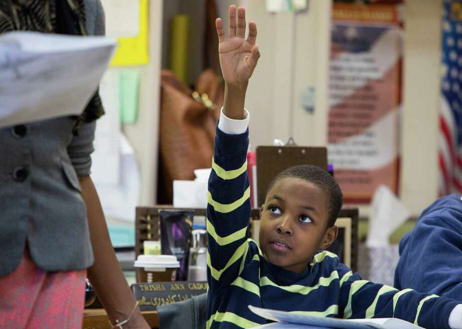 Chrispin Alcindor, a fourth-grade student who is struggling to grasp the new requirements placed on him by Common Core, at Public School 397 in New York, March 27, 2014. Common Core focuses on critical thinking to lift achievement at low-performing schools, but if the standards are going to succeed, schools have to rise to the rigor of the new demands. (Ruth Fremson/The New York Times) ORG XMIT: XNYT33 Photo: RUTH FREMSON / THE NEW YORK TIMES