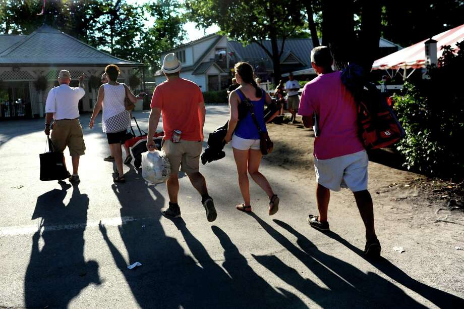 Racing fans make their way home after the final day of the season on Tuesday, Sept. 7, 2015, at Saratoga Race Course in Saratoga Springs, N.Y. (Cindy Schultz / Times Union) Photo: Cindy Schultz / 00033234A