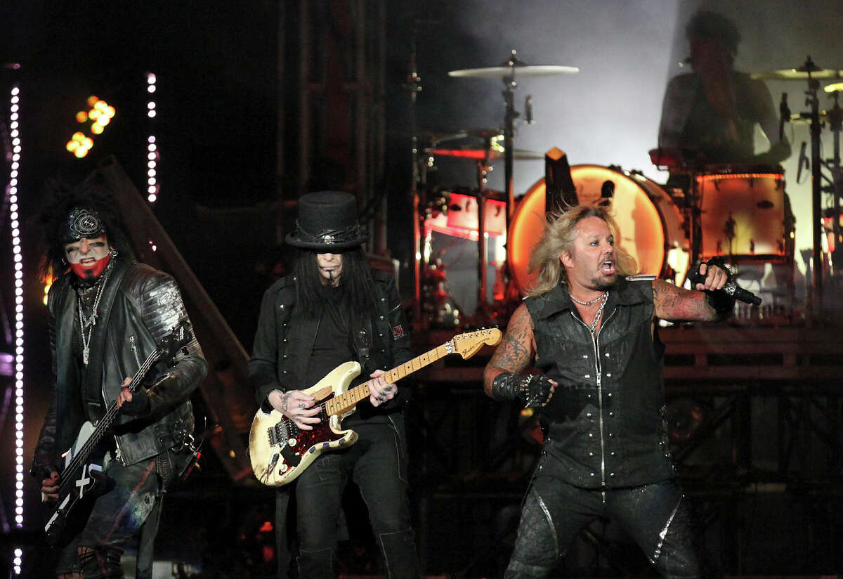 Motley Crue's Nikki Sixx (from left), Mick Mars, Vince Neil, and Tommy Lee (background) perform Sunday Sept. 6, 2015 at the Alamodome.