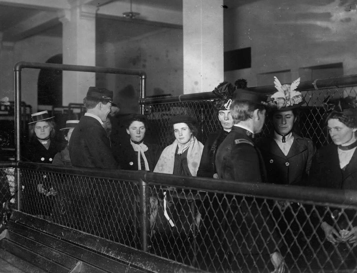 FILE - This photo made between 1907 and 1917 and made available by the Library of Congress shows immigrants at Ellis Island, New York.