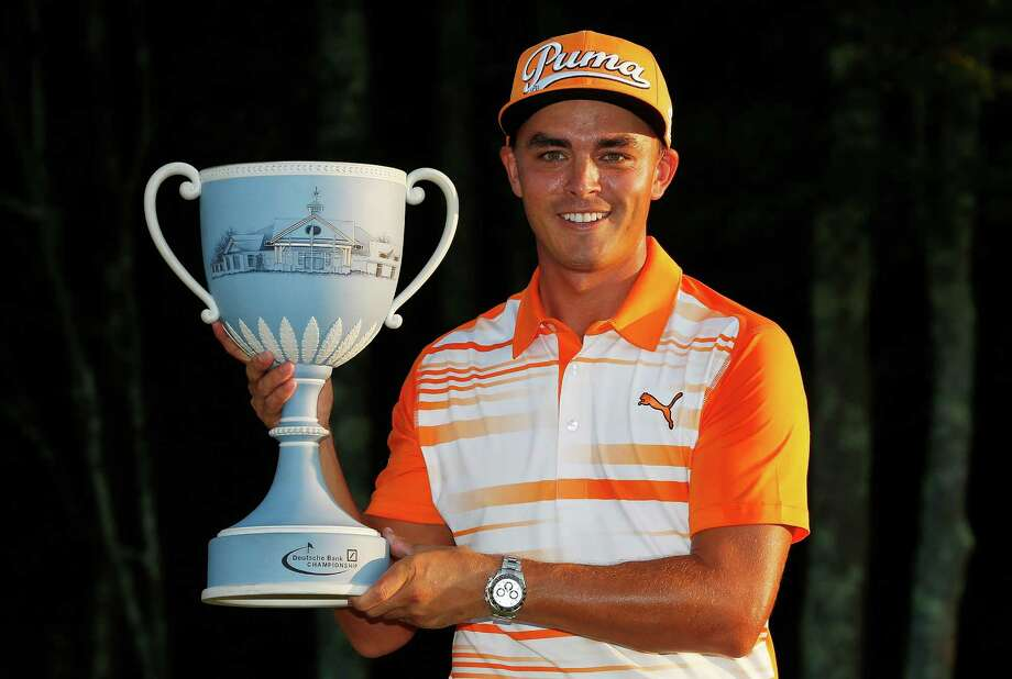 Rickie Fowler holds the trophy after winning the Deutsche Bank Championship golf tournament in Norton, Mass., Monday, Sept. 7, 2015. (AP Photo/Michael Dwyer) ORG XMIT: MAMD109 Photo: Michael Dwyer / AP