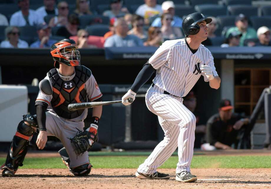New York Yankees' Greg Bird, right, hits a three-run home run as Baltimore Orioles catcher Caleb Joseph, left, looks on during the seventh inning of a baseball game Monday, Sept. 7, 2015, at Yankee Stadium in New York. (AP Photo/Bill Kostroun) ORG XMIT: NYY111 Photo: Bill Kostroun / FR51951 AP