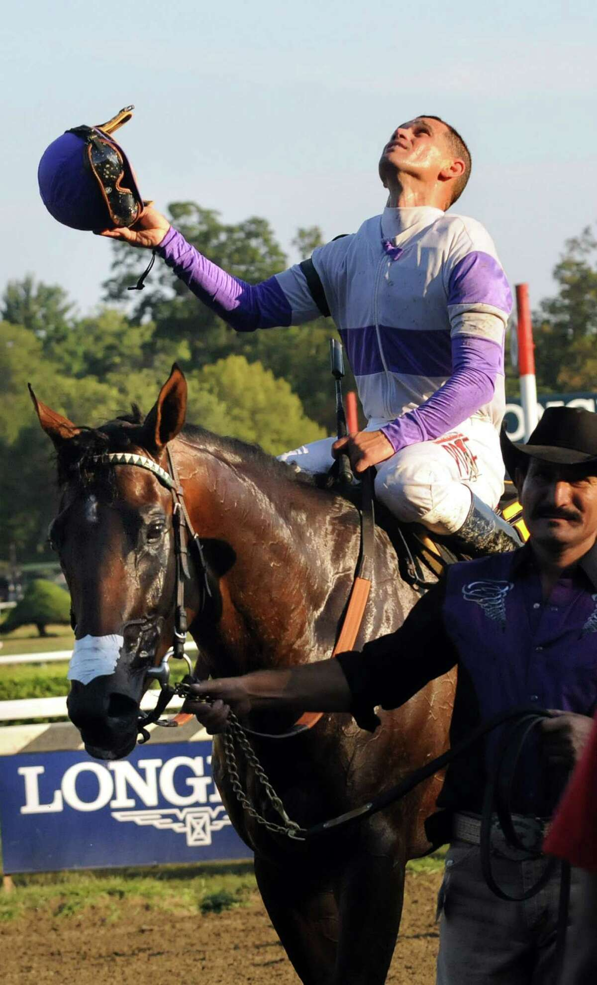 Jockey Javier Castellano celebrates atop Ralis after they take first in The Hopeful grade I race on Tuesday, Sept. 7, 2015, at Saratoga Race Course in Saratoga Springs, N.Y. (Cindy Schultz / Times Union)