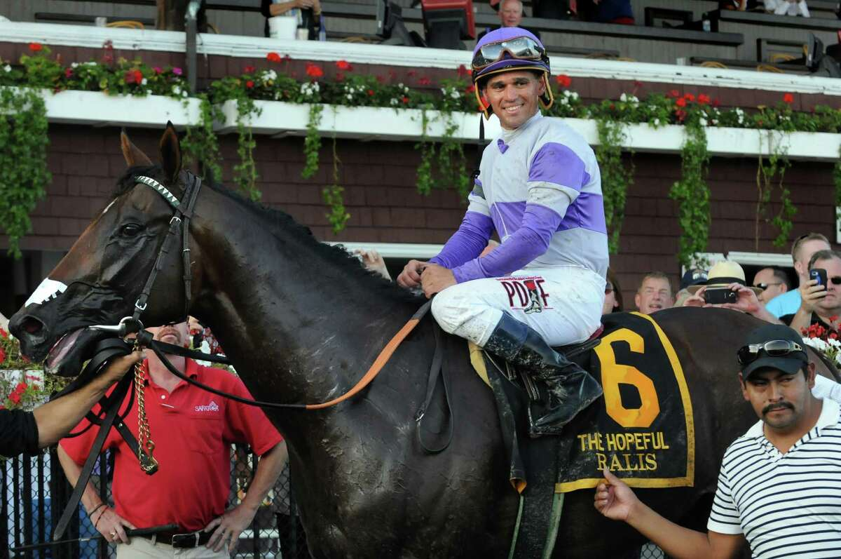 Jockey Javier Castellano poses atop Ralis in the winner's circle after The Hopeful grade I race on Tuesday, Sept. 7, 2015, at Saratoga Race Course in Saratoga Springs, N.Y. (Cindy Schultz / Times Union)