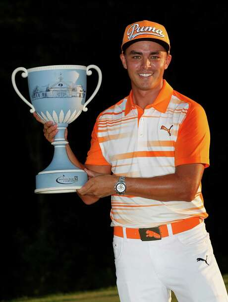 Rickie Fowler holds the trophy after winning the Deutsche Bank Championship golf tournament in Norton, Mass., Monday, Sept. 7, 2015. (AP Photo/Michael Dwyer) Photo: Michael Dwyer, STF / AP