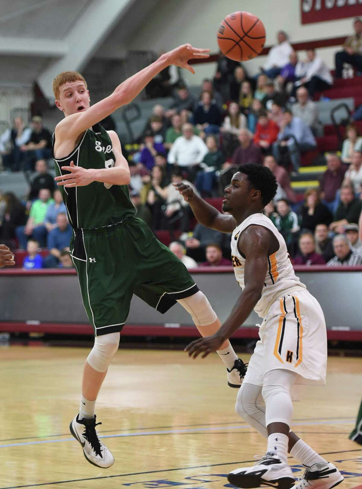Shenendehowa's Kevin Huerter (3) passes the ball under pressure versus Henninger in the New York State Class AA Regional final at Colgate University, Hamilton, N.Y., Saturday March 13, 2015. (Scott Schild / Special to the Times Union) ORG XMIT: 94825