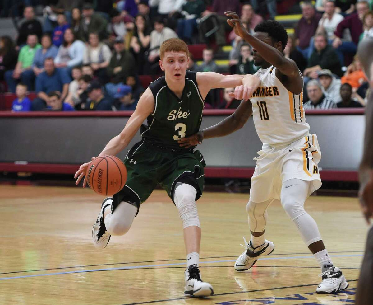 Shenendehowa's Kevin Huerter (3) drives the lane defended by Henninger's Keisean Scott (10) in the New York State Class AA Regional final at Colgate University, Hamilton, N.Y., Saturday March 13, 2015. (Scott Schild / Special to the Times Union) ORG XMIT: 94825