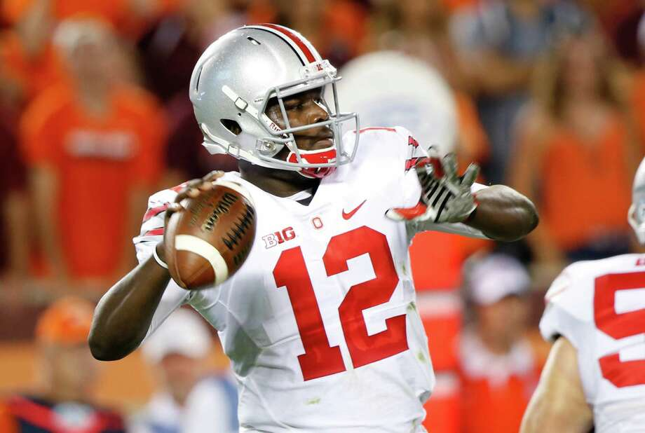 Ohio State quarterback Cardale Jones (12) looks for a receiver during the first half of an NCAA college football game against Virginia Tech in Blacksburg, Va., Monday, Sept. 7, 2015. (AP Photo/Steve Helber) Photo: Steve Helber, STF / Associated Press / AP