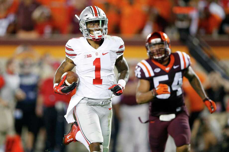 Quarterback-turned-receiver Braxton Miller provides an example of his versatility by breaking free on a 53-yard touchdown run in the third quarter. Photo: Joe Robbins, Stringer / 2015 Getty Images