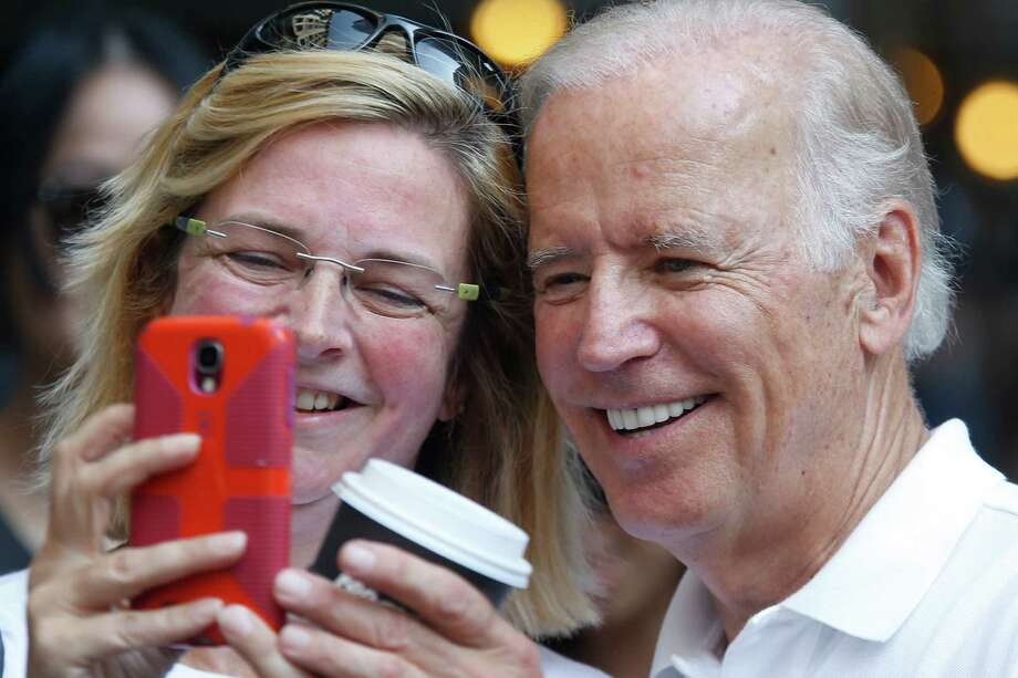 Vice President Joe Biden, right, is photographed with one of the people lining the street as Biden walks in the annual Labor Day parade on Monday, Sept. 7, 2015, in Pittsburgh. (AP Photo/Keith Srakocic) Photo: Keith Srakocic, STF / Associated Press / AP