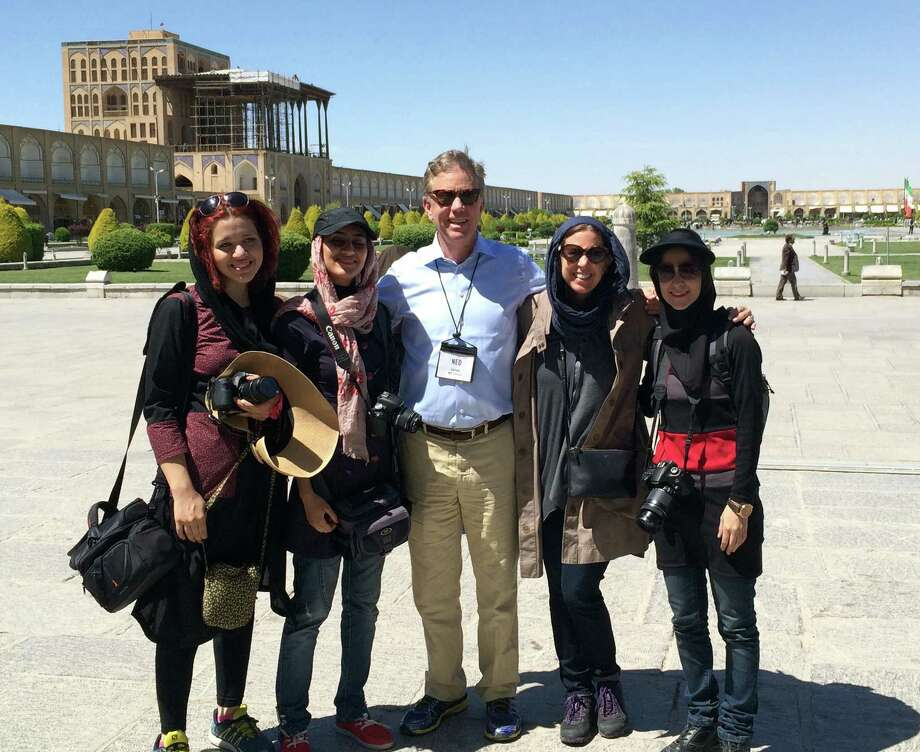 Greenwich residents Ned Lamont, center, and Jenny Baldock, to the right of Lamont, pose with a group of Iranian women at Imam Square in Isfahan, Iran during their recent visit to Iran. Photo: Contributed Photo / Greenwich Time Contributed Photo