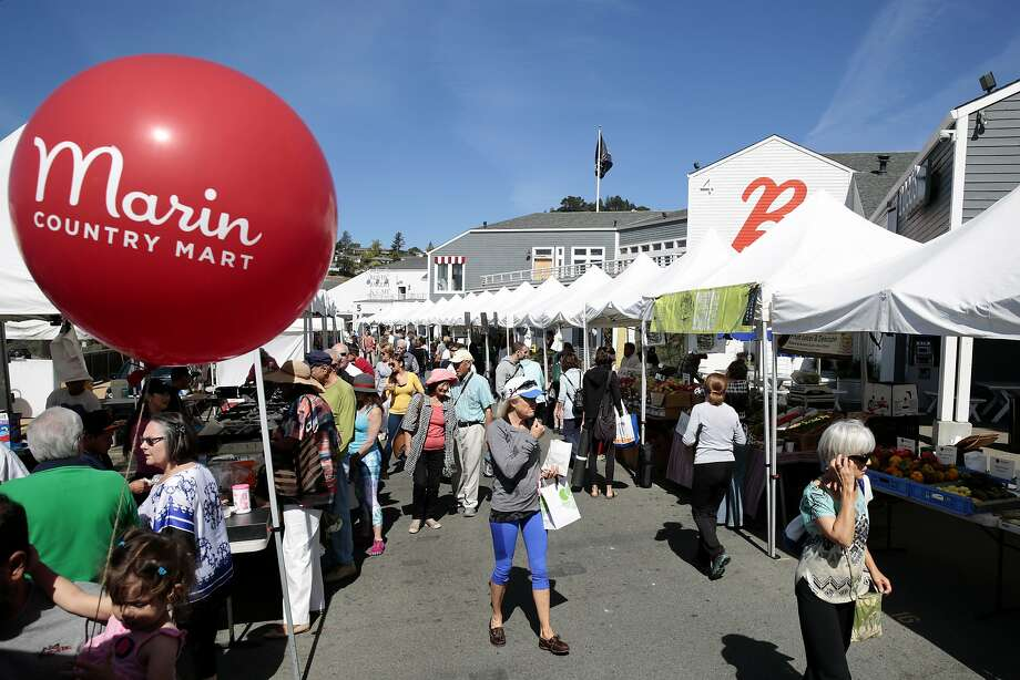 Young ones will love the Marin Country Mart's farmers' market — there's no shortage of entertainment with face painting, pony rides, live music, storytelling, and arts and crafts staggered throughout the day — don't forget to snag a signature big red balloon, too. Photo: Ramin Rahimian, Special To The Chronicle