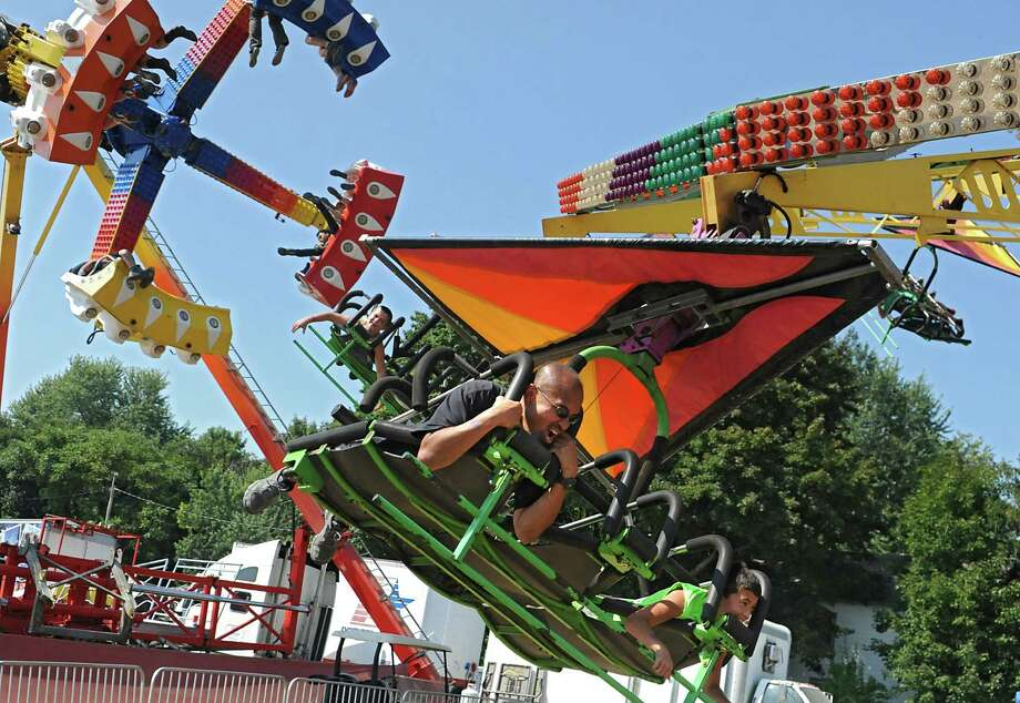 People enjoy the rides at the Columbia County Fair on Monday, Sept. 7, 2015 in Chatham, N.Y.  (Lori Van Buren / Times Union) Photo: Lori Van Buren / 10032907A