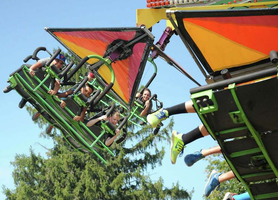 People enjoy the hang glide ride at the Columbia County Fair on Monday, Sept. 7, 2015 in Chatham, N.Y.  (Lori Van Buren / Times Union) Photo: Lori Van Buren / 10032907A