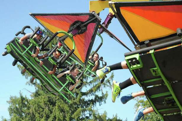 People enjoy the hang glide ride at the Columbia County Fair on Monday, Sept. 7, 2015 in Chatham, N.Y.  (Lori Van Buren / Times Union)