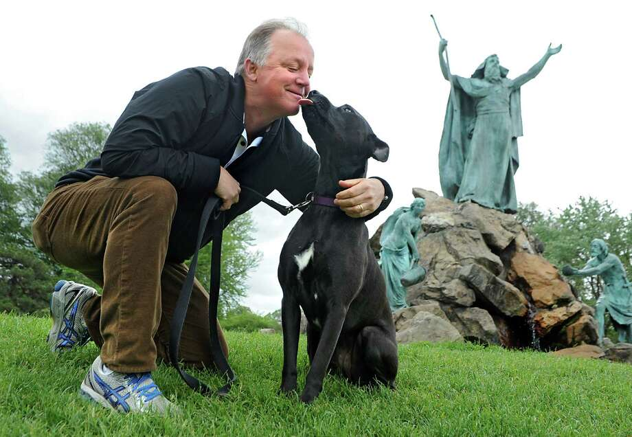 Paul Grondahl gets a kiss from his dog Lily in Washington Park in Albany, N.Y. (Lori Van Buren / Times Union) Photo: Lori Van Buren / 00031921A