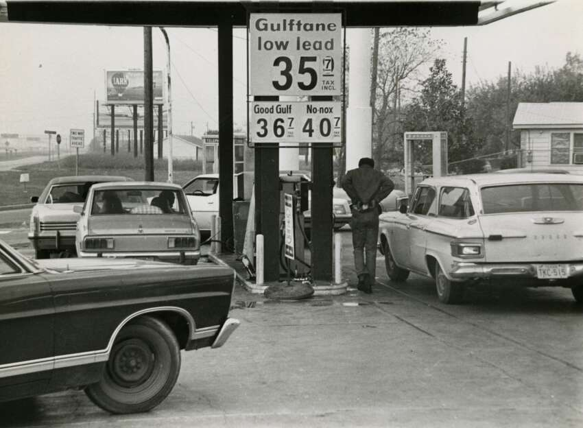 In December 1973, cars line up on